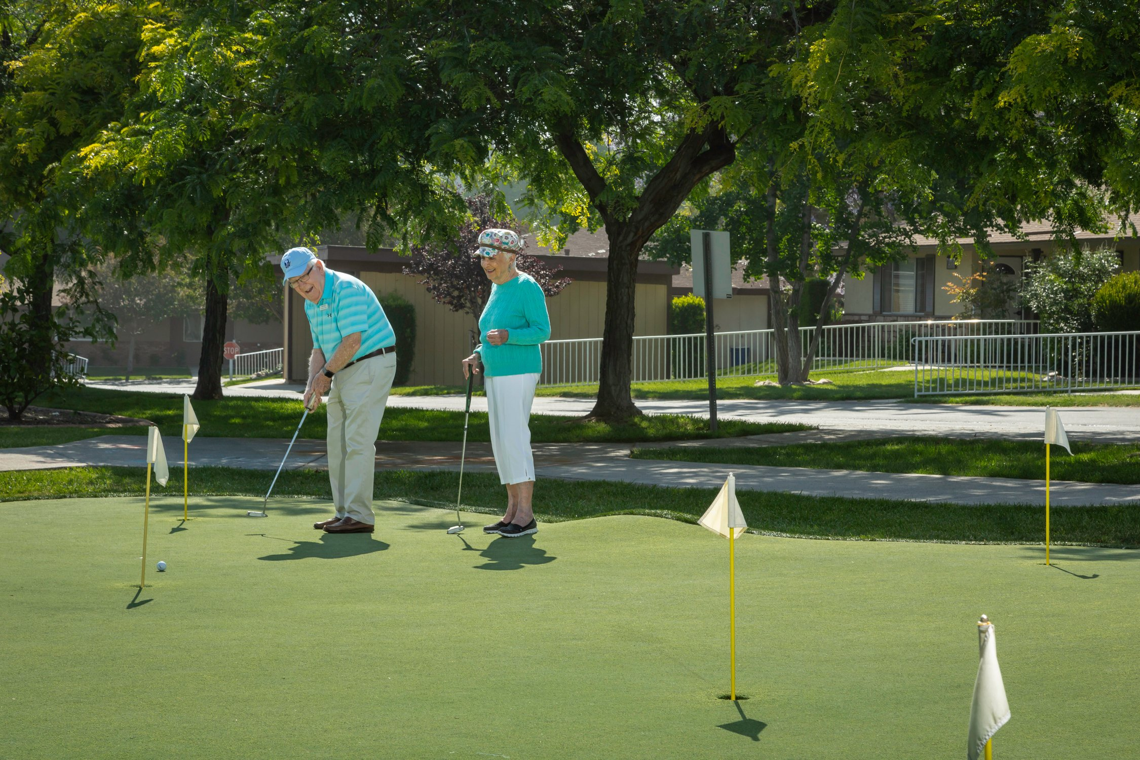 couple on the putting green