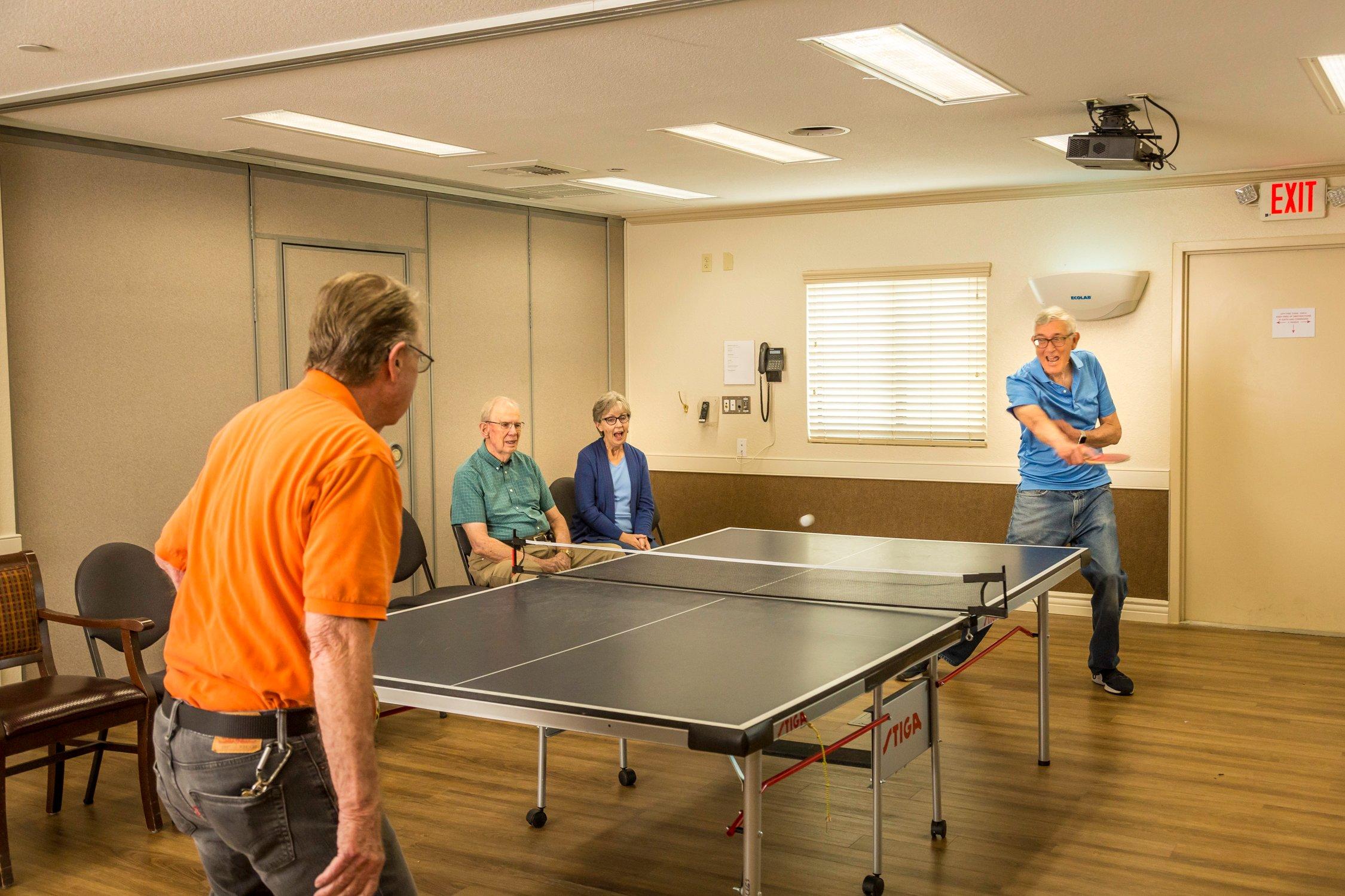 guys playing ping pong