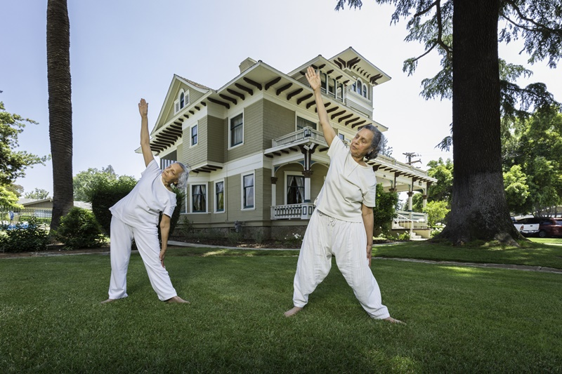 residents enjoy yoga outside