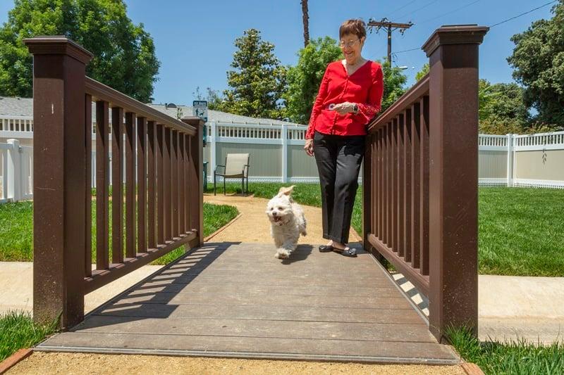 resident walks down on bridge outside