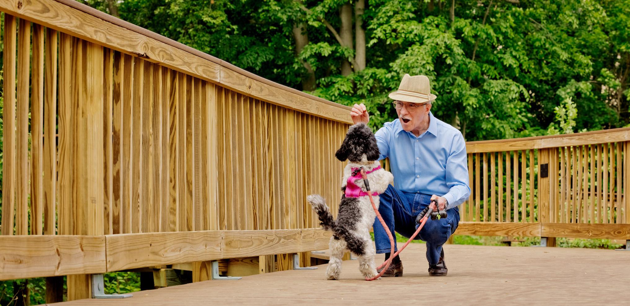 man with dog at senior living community