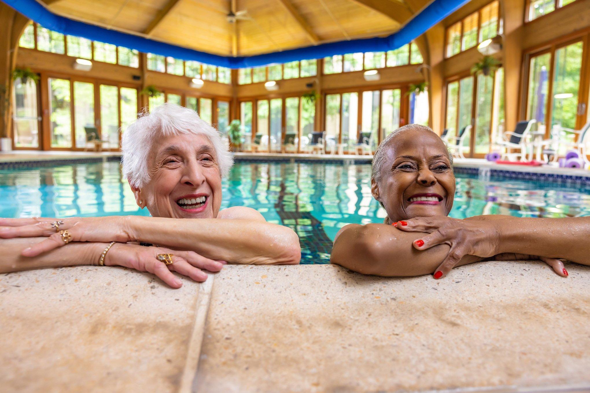 two women at pool in senior living community