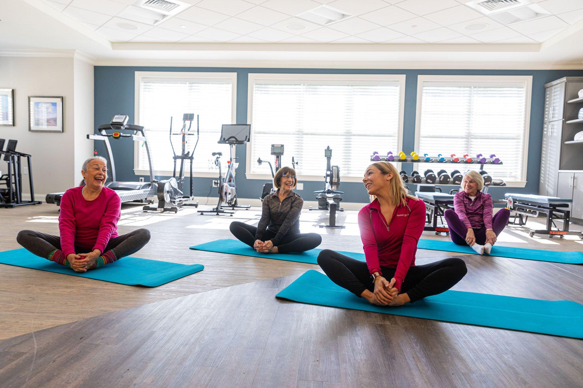 four women doing yoga