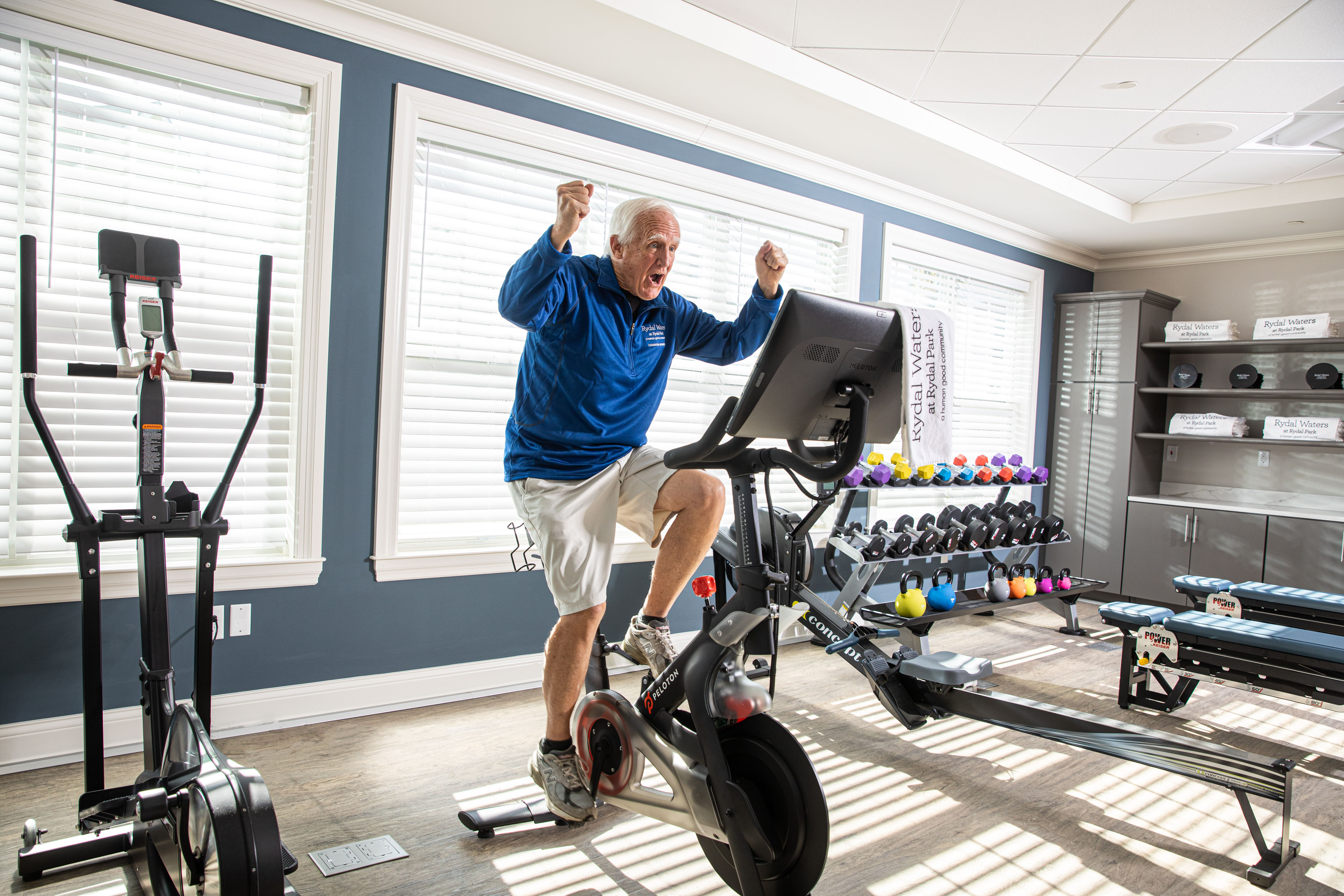 man riding bike in Rydal Waters's gym