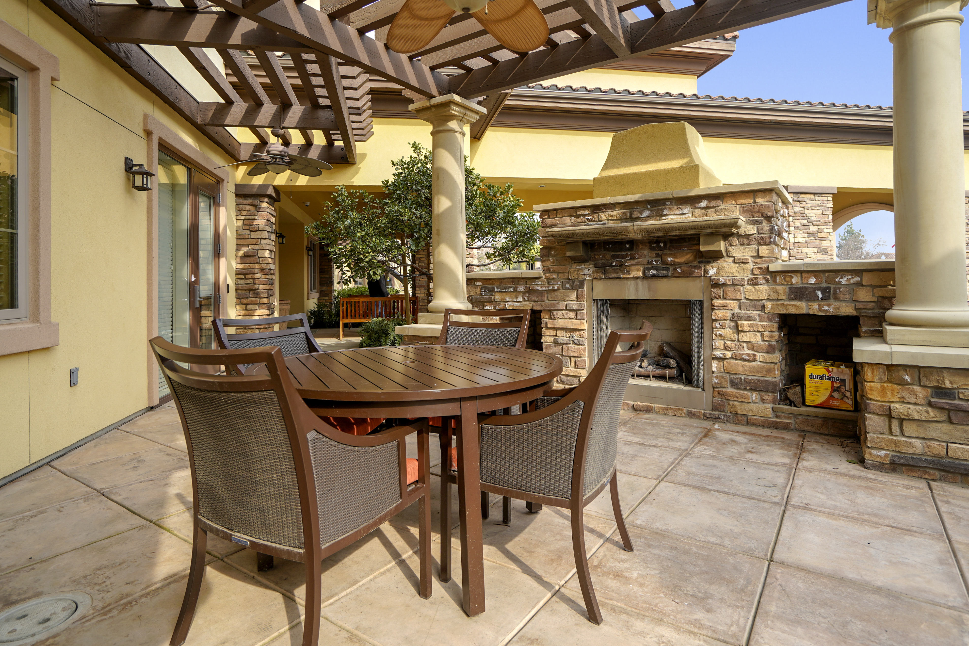 exterior patio with outdoor fireplace