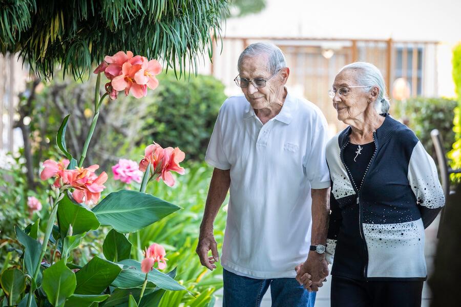 Windsor couple walking by flowers
