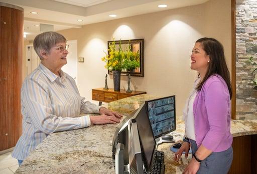 receptionist talking with piedmont garden resident