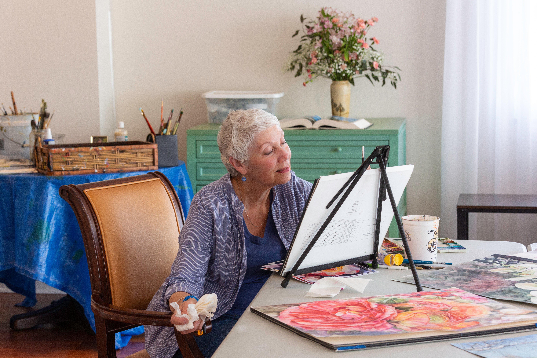 female resident paints a portrait