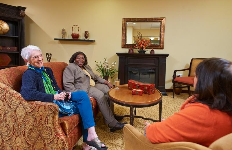 3 women sit around talking