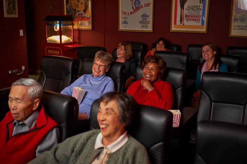 residents enjoy a movie