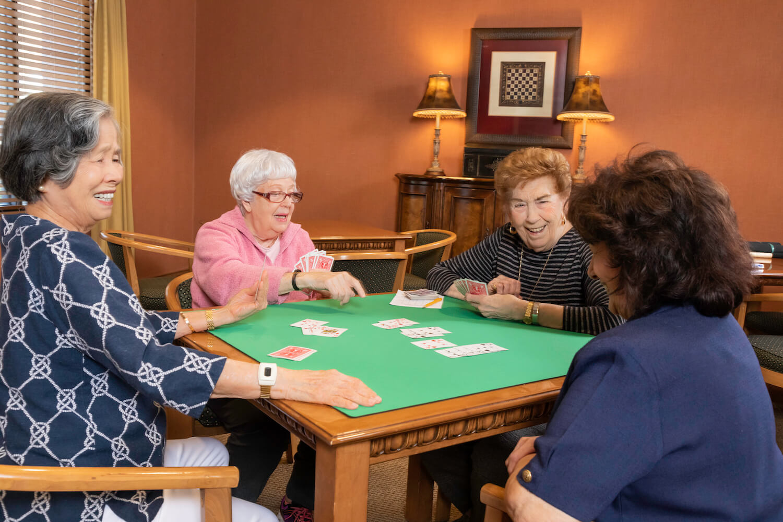 25-4 ladies playing bridge