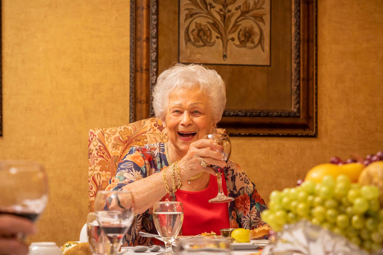 21-dining - woman raising a glass