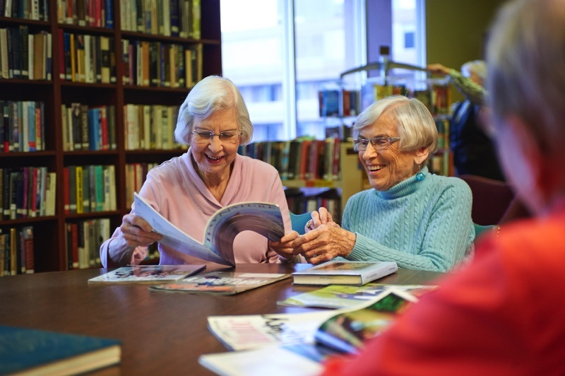 two residents enjoy the community library