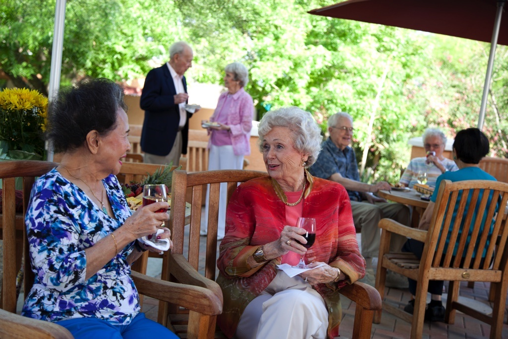 multiple people drinking wine