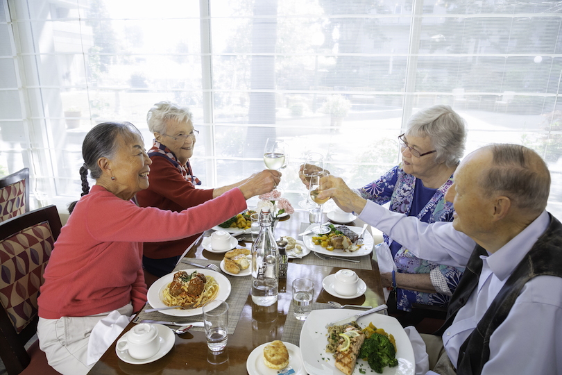 Piedmont garden residents dine together in a restaurant
