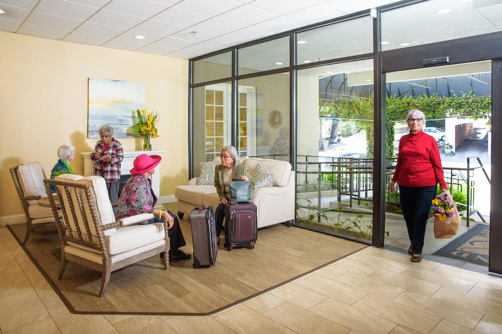 residents in lobby; with suitcases
