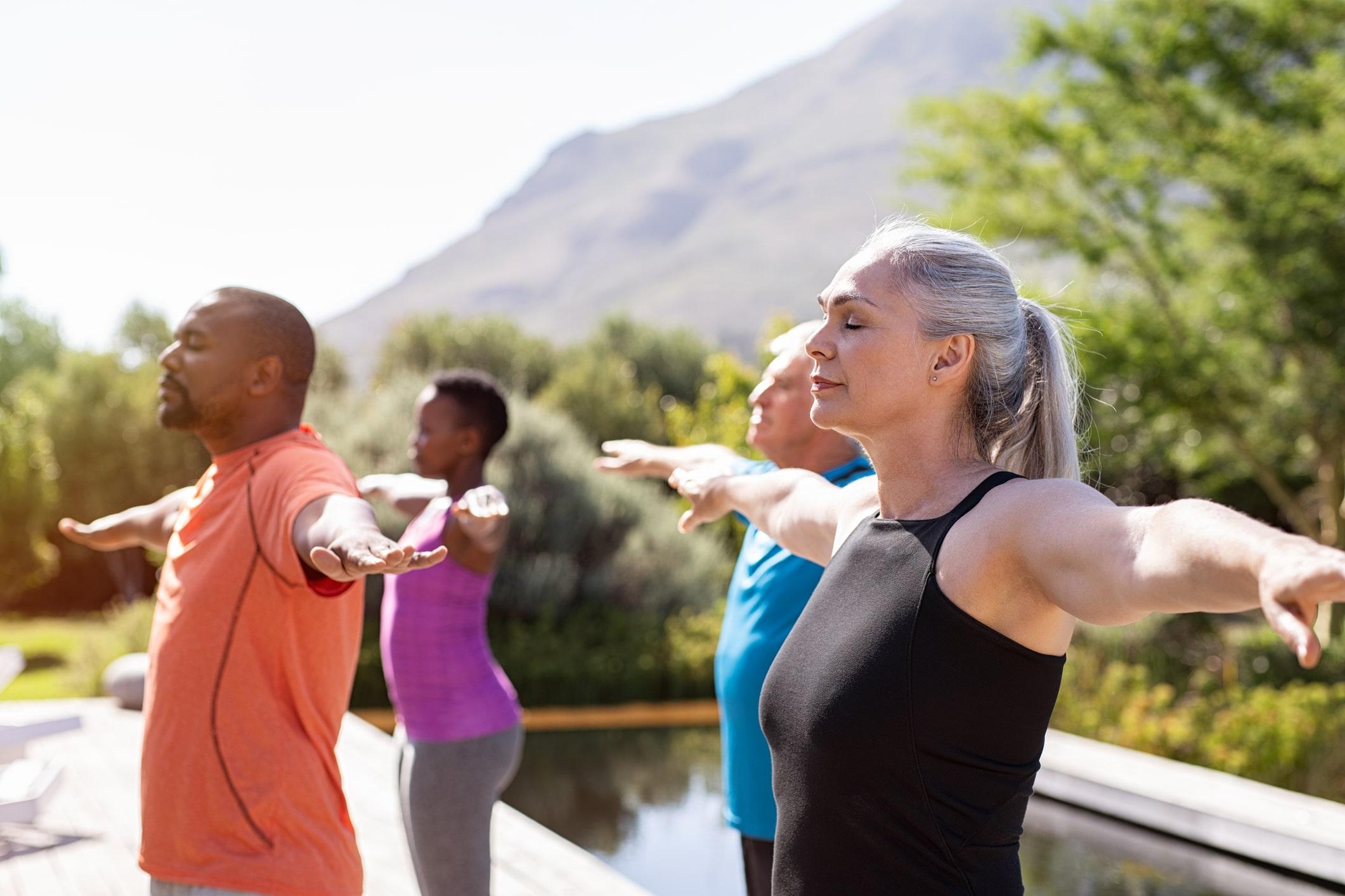 Seniors doing yoga outside