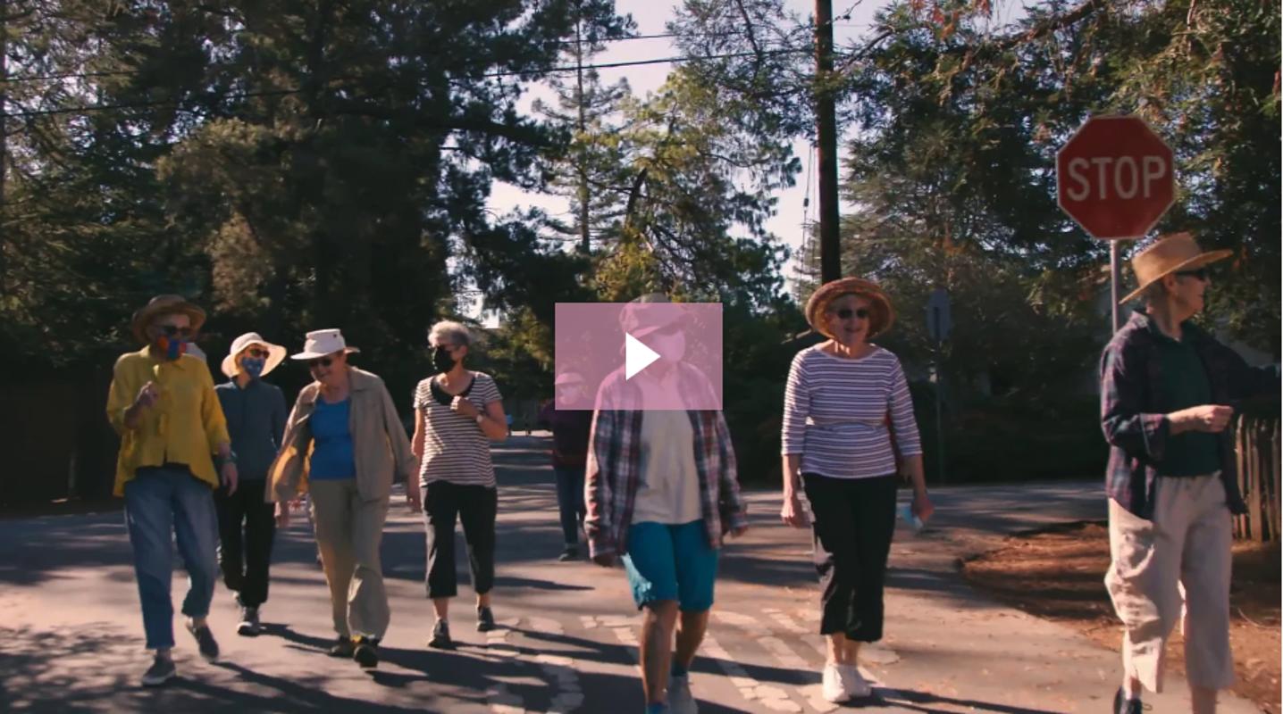 Group of active seniors walking outside
