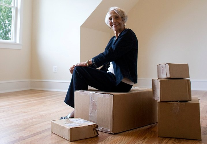 Older woman sitting on boxes